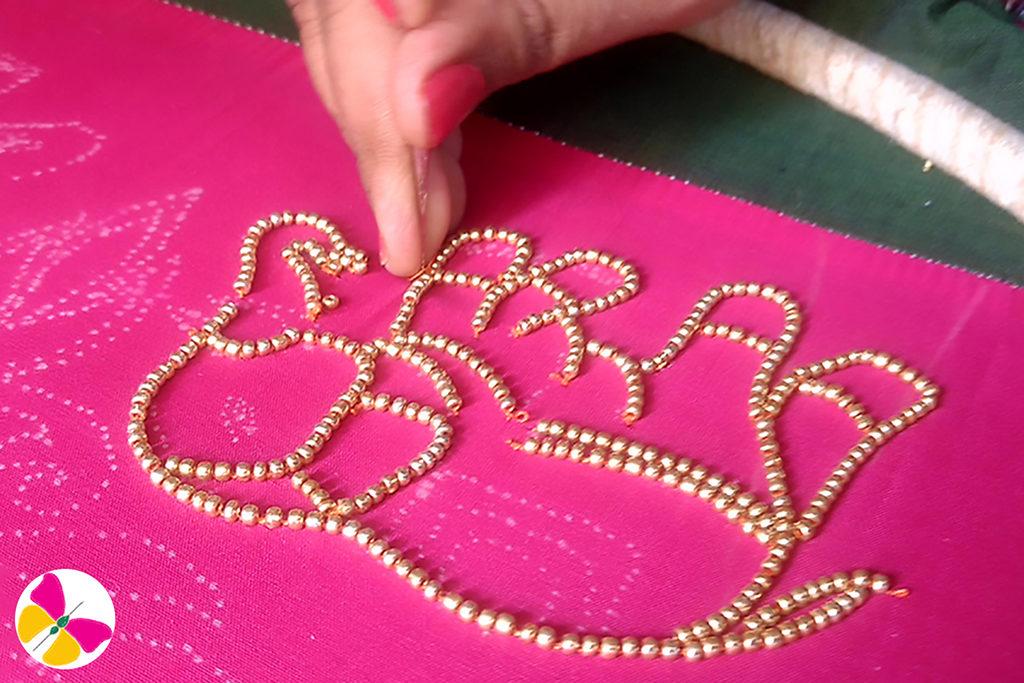 Gold beads stitching